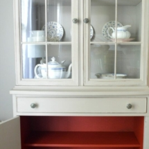 Persimmon and Greige Farmhouse Cabinet