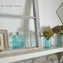 vintage window, vintage glass, Whitewashed Brick Hearth by www.thepainteddrawer.com Before and After on Blog, farmhouse room