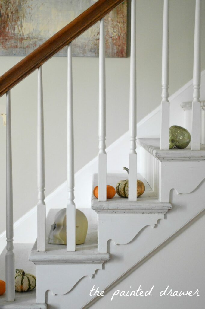 Painted Stairs in foyer www.thepainteddrawer.com