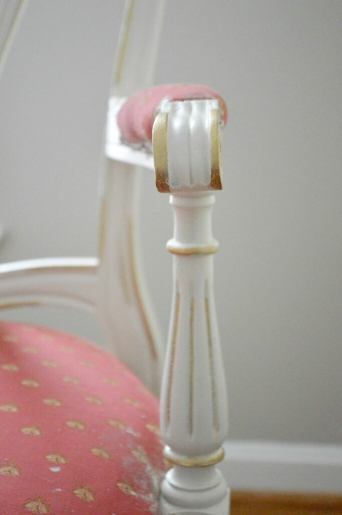 Gold Gilding wax over antique white paint on vintage french dining chair at www.thepainteddrawer.com