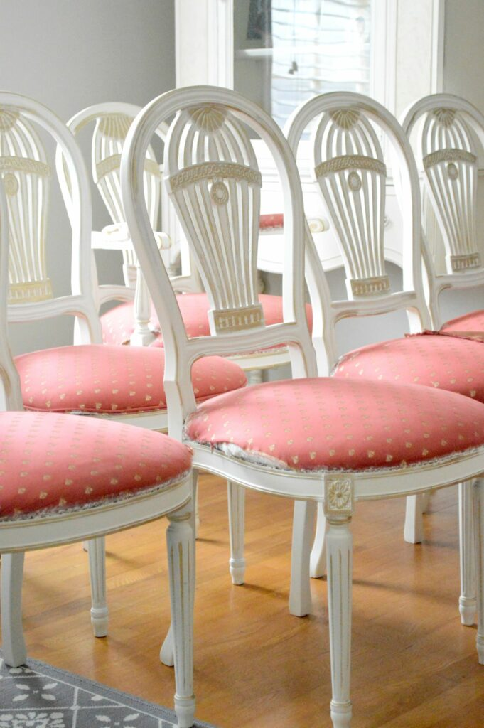 Vintage Balloon Back Dining Room chairs with Gold Gilding wax over antique white paint at www.thepainteddrawer.com