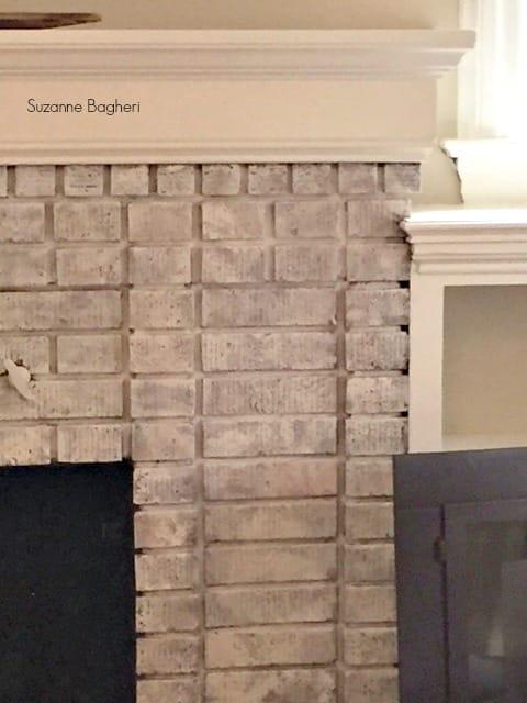whitewashed brick fireplace